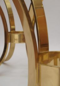 Brass and glass side tables detail