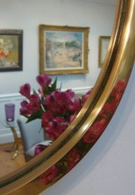 Small oval brass mirror detail